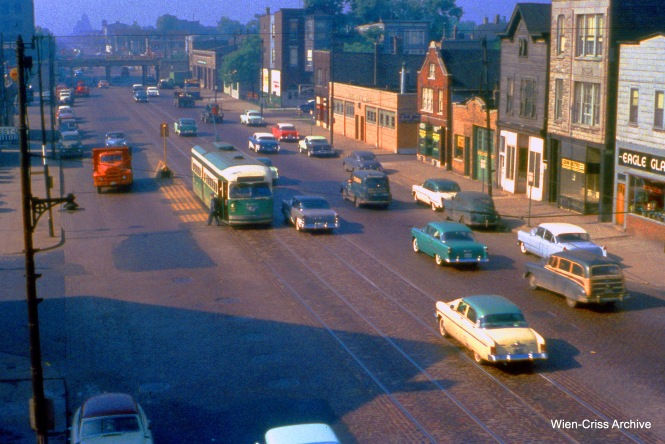 """CTA 4060 is on Western at the Logan Square """"L"""" on June 8, 1956. In the background, you can see the viaduct which is now part of the 606 Trail. (Wien-Criss Archive)"""