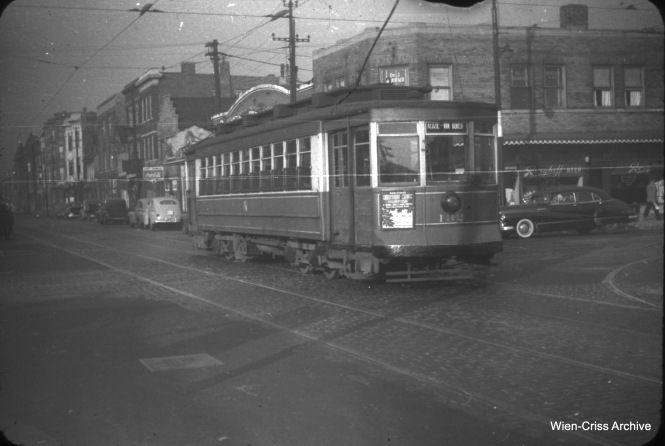 "Westbound CTA Pullman 132 is on Van Buren crossing Western Avenue on November 13, 1950. Streetcar service ended on this route in 1951, and the CTA used the south half of Van Buren as a temporary right-of-way for Garfield Park ""L"" cars between 1953 and 1958. (William C. Hoffman Photo, Wien-Criss Archive)"
