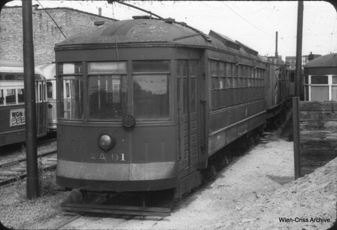 "CTA salt car AA91 is at the car barn at Clark and Schreiber on August 15, 1953. Dpn's Rail Photos adds, ""AA91, salt car, was built by Chicago Rys in 1912 as 1545. It became CSL 1545 in 1914 and retired on November 19, 1947. It was rebuilt as salt car AA91 in 1948 and retired on September 8, 1955."" (William C. Hoffman Photo, Wien-Criss Archive)"