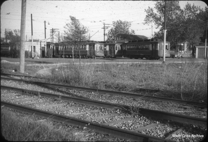 The turnback loop at 63rd Place and Narragansett was built in 1948 to accomodate PCC cars, which were single-ended. But towards the end of streetcar service on Route 63, PCCs were removed and red cars were, for a short time, returned, as this May 19, 1953 view shows. Buses replaced streetcars five days later, and began running on 63rd Street between Narragansett and Central, instead of on 63rd Place, as streetcars had. (William C. Hoffman Photo, Wien-Criss Archive)