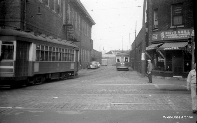 The view looking west across Halsted into Root Street terminal. Streetcar service on this line was abandoned two days after this picture was taken on August 7, 1953. (William C. Hoffman Photo, Wien-Criss Archive)