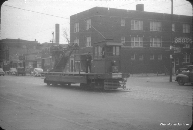 CTA work car X-201 is heading west on 63rd Street on April 18, 1948, to take up rail from the Argo line, where streetcar service ended a week earlier. (William C. Hoffman Photo, Wien-Criss Archive)