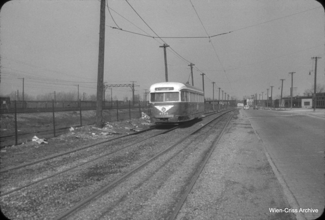 On March 21, 1954, CTA PCC 4025 heads north on Cottage Grove at 98th. Here, streetcars were on open track west of the roadway. (William C. Hoffman Photo, Wien-Criss Archive)