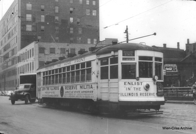 The CSL car is promoting the Illinois Reserve Militia on State Street during World War II. (William C. Hoffman Photo, Wien-Criss Archive)