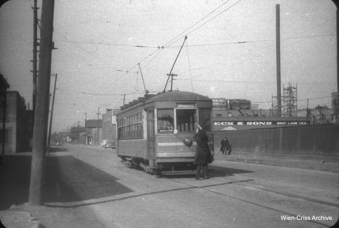 The operator of one-man car 2908 is changing ends on 39th Street on March 28, 1948. At the moment, both poles are up. Not sure of the exact location. (William C. Hoffman Photo, Wien-Criss Archive)