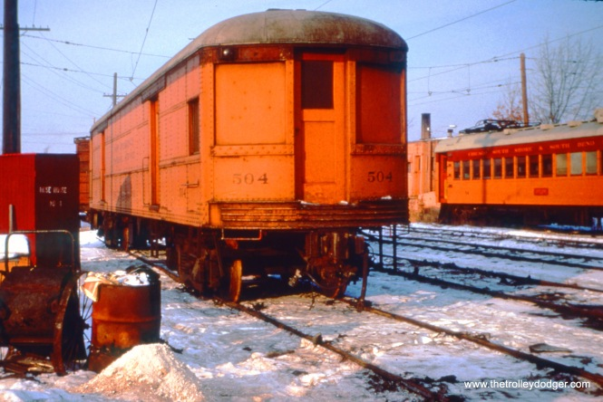"SSL baggage car 504 is in the coach yard on the north side of Shops on December 26, 1963. Don's Rail Photos: ""377 was built by St Louis Car Co in 1926 as ISC 377. It was assigned to IRR as 377 in 1932 and rebuilt as a combine in 1935. It was sold to CSS&SB as 504 in 1941 and used in 1942 as a straight baggage car. It was rebuilt in 1955 with windows removed and doors changed."" (John D. Horachek Photo, William Shapotkin Collection)"