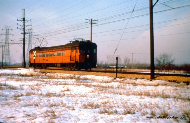 SSL car 100 (train 9) is eastbound at the Lake Park Avenue crossing in the Lake Shore community just west of Michigan City on December 26, 1963. (John D. Horachek Photo, William Shapotkin Collection)