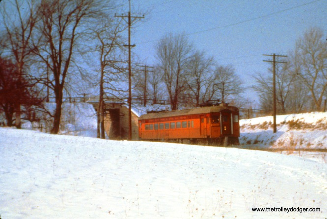 South Shore car 197 (train 15) has just gone through the underpass at Emery Road at Hicks, which had once been a flag stop, on December 26, 1963. (John D. Horachek Photo, William Shapotkin Collection)