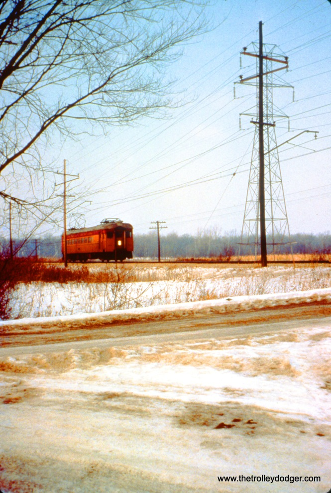 South Shore car 111 (train 11) is 24 miles from South Bend, between Lalumiere and Bishop on December 26, 1963. (John D. Horachek Photo, William Shapotkin Collection)