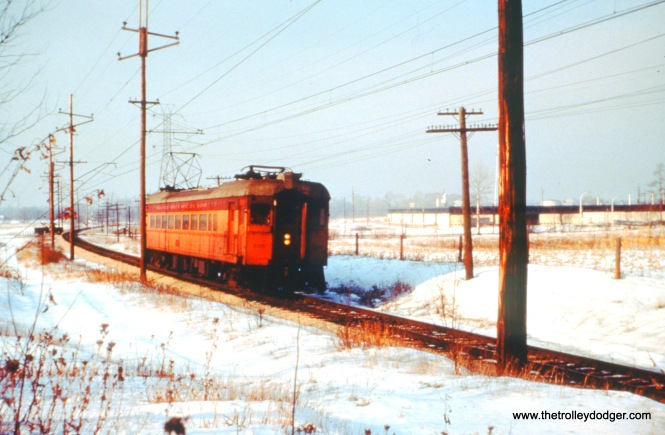 South Shore Line car 108 (train 11) approaches Cook Road at speed, a mile east of the Shops, on December 26, 1963. (John D. Horachek Photo, William Shapotkin Collection)