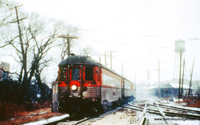 NSL train 410 leaves North Chicago Junction, where the tracks at right, which were formerly part of the Shore Line Route, but were only used for the Highwood Shops when this picture was taken on December 9, 1962. (John D. Horachek Photo, William Shapotkin Collection)