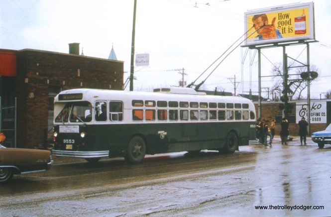 CTA trolley bus 9553, on an Omnibus Society of america fantrip, is eastbound on Fullerton, crossing the Milwaukee Road at Lakewood Avenue on April 1, 1973, final day of TB service in Chicago. The view looks southwest. (Robert Barth Photo, William Shapotkin Collection)