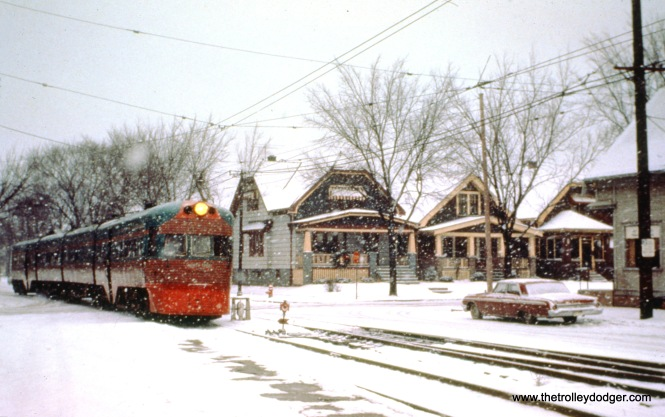 NSL train 802, with Electroliner 803-804, goes onto private right-of-way at 5th and Harrison Streets in Milwaukee on December 31, 1962. (John D. Horachek Photo, William Shapotkin Collection)
