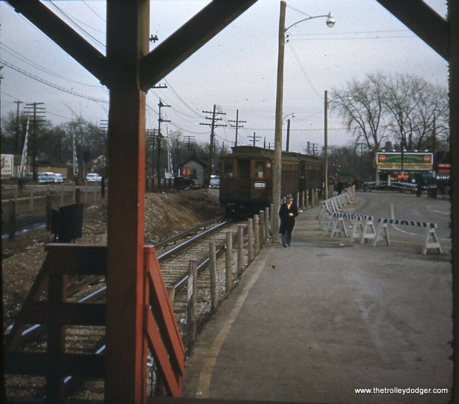 The train seen in a previous picture approaches the terminal. During construction of the nearby expressway in the late 1950s, there were temporary tracks just to the right, and the stores on Des Plaines Avenue were demolished.
