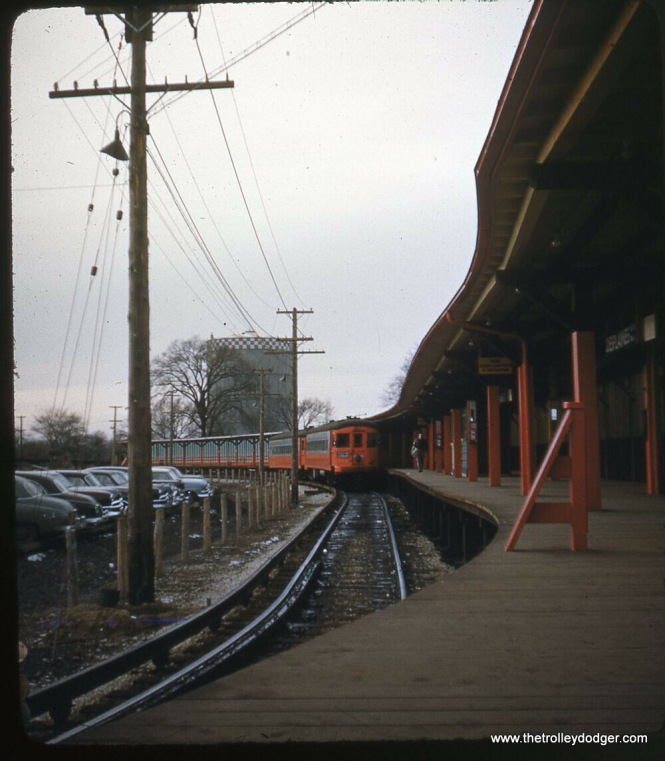 From 1953 to 1957, passengers could change trains here between the CA&E and CTA. The gas holder shown was a long-time Forest Park landmark.