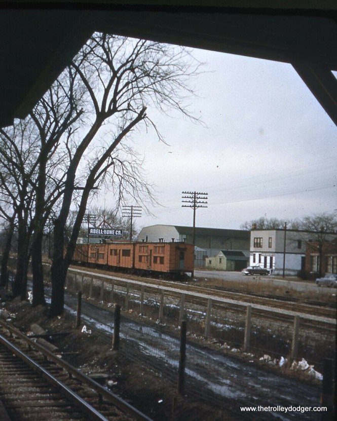 "What are these strange looking freight cars on the Chicago Great Western, just north of the CTA tracks at DesPlaines Avenue? Thomas Kaufman: ""That photo in the ones that got away showing a train on the Chicago Great Western appears to be some Maintenance of Way bunk cars used to hold sleeping quarters for the employees. Another giveaway is the orange paint as M of Way cars are generally painted different colors than the standard freight equipment."" Andre Kristopans thinks some of those cars could date to the 1880s."