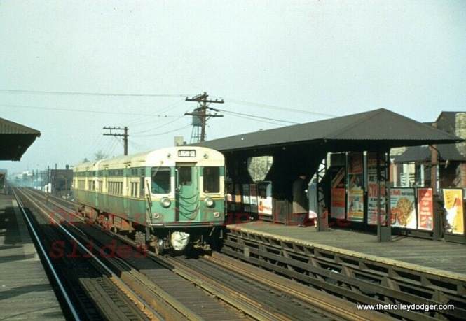 A two-car CTA train of flat-door 6000s is running on the Logan Square route. This may be California Avenue. However, why is there a bag over the coupler? This picture was probably taken in the 1950s.