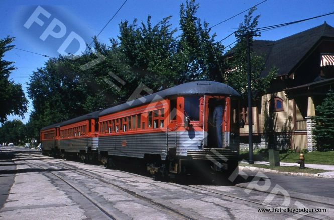 I had expected a friend to possibly bid on this nice 1955 North Shore Line picture, but he demurred. We all have our standards for what constitutes a good photo. He said he already had other shots like this, and this shows the back of the train. At any rate, this is street running in Milwaukee.