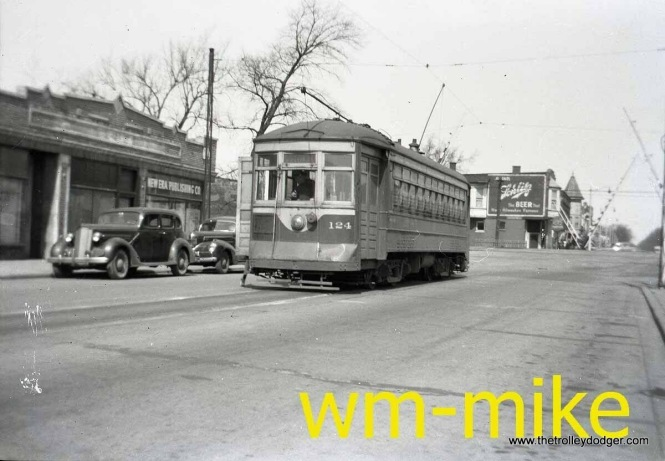 "Not sure where this picture of C&WT 124 was taken... Maywood? Or could this be Madison Street in Forest Park? Bill Shapotkin adds: ""This photo was taken in Maywood. The car is in 19th Ave and the west end of the Madison St Line. The Grade crossing in the background is the C&NW-IHB (the ""Melrose Park"" C&NW station would be located to right). View looks north."""