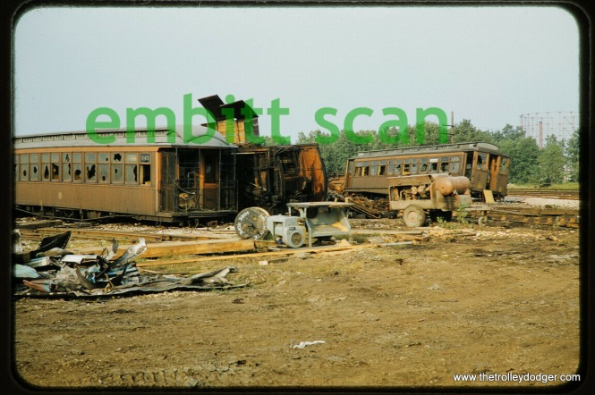"CTA wooden ""L"" cars, including 345 at left, and a Met car at right, being scrapped at Skokie Shops in September 1957."