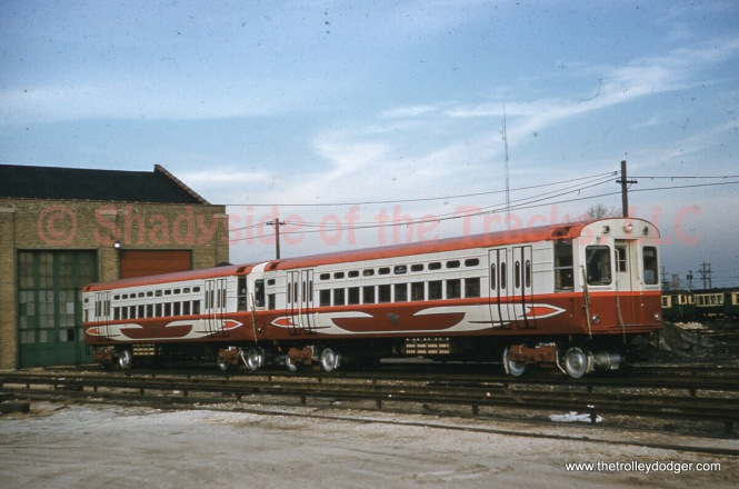 "This very nice picture shows two of the CTA's new single car units on November 25, 1960, and was taken by Robert E. Bruneau. These were given high-speed motors and ""circus wagon"" colors for a time."