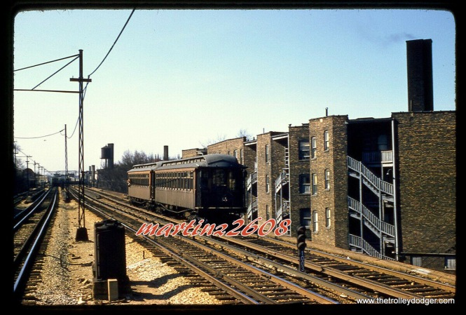 "A two-car CTA wooden ""L"" train on April 13, 1957. I would expect that we are not too far south of Howard Street."