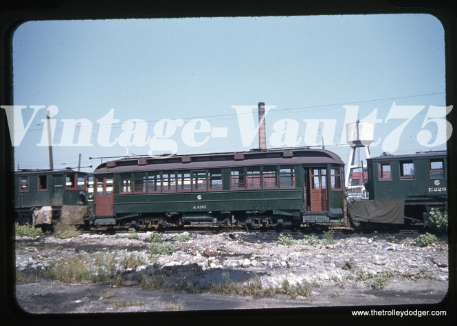 "CSL/CTA work car AA101 at 77th and Vincennes in 1955. Don's Rail Photos adds: ""AA101, salt car, was built by South Chicago City Ry in 1907 as SCCRy 335. It was rebuilt in 1907 and became C&SCRy 834 in 1908. It was renumbered 2849 in 1913 and became CSL 2849 in 1914. It was later converted as a salt car and renumbered AA101 in 1948. It was retired on December 14, 1956."