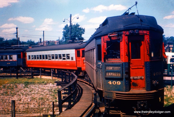This photo of CA&E 409 and trainw as taken between 1953 and 1957 at the DesPlaines Avenue terminal in Forest Park. Once the interurban stopped running downtown, due to construction of the Congress Expressway (now Eisenhower), trains looped here. CTA trains made a different loop on a wooden elevated structure just to the west of the station. (Steve Hyett Photo)