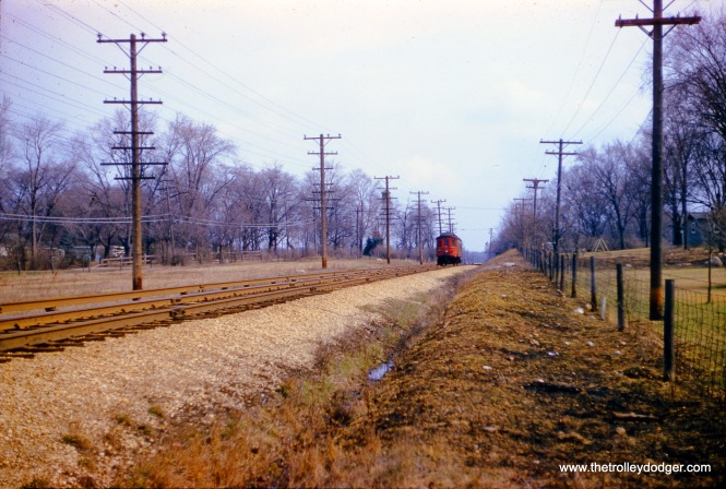 "CA&E 422 is ""at speed"" on the Aurora branch west of Wheaton on March 28, 1957. Given the slow film speed of the time, many photographers pressed the shutter button before moving trains got too close, lest their pictures end up with motion blur."