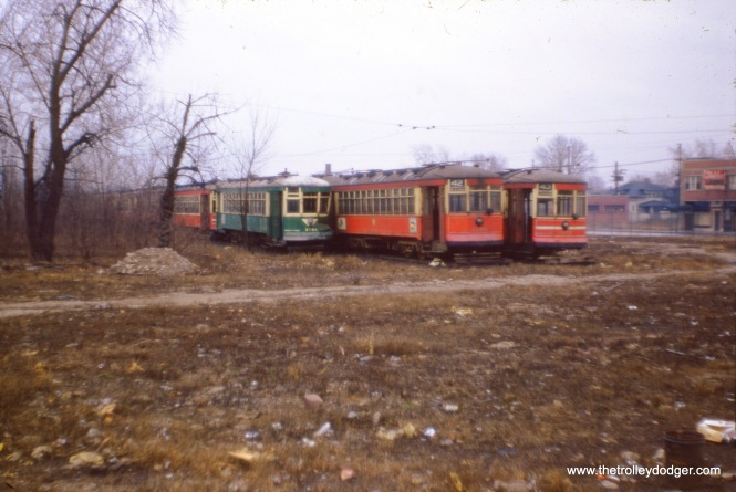 CTA red cars (and one that was repainted green) on the scrap line in 1954. Visible in this photo, from left to right, are 3141, 3179, and 3151. Sister car 3142 is now at the Illinois Railway Museum. (J. W. Vigrass Photo)