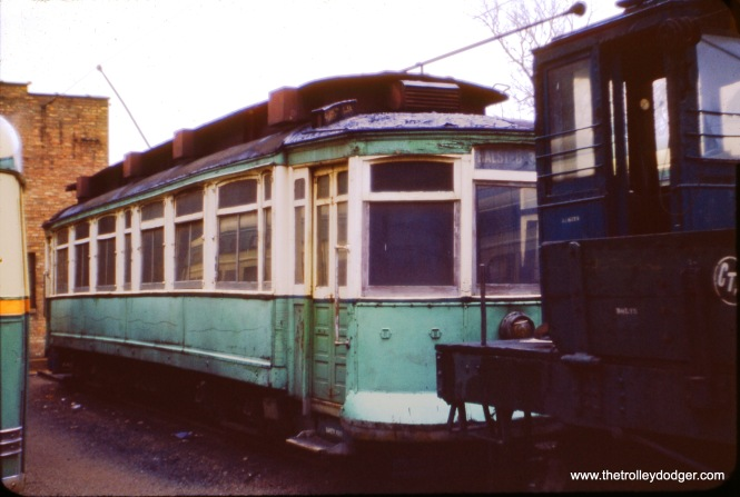 I am not sure what number CTA car this is, in this 1954 photo, or why it is painted green instead of red. (J. W. Vigrass Photo)