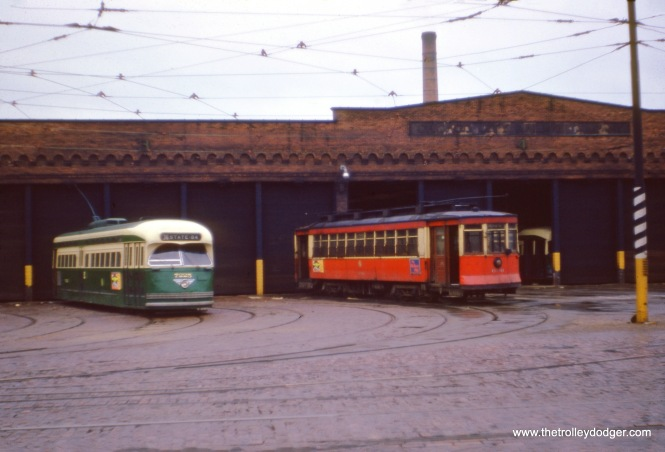 "CTA PCC 7225, signed for Route 36 -Broadway-State, and red car 690, probably in 1954. But which station (car barn) is this? (J. W. Vigrass Photo) Our resident South side expert M. E. adds, ""My guess is the Vincennes/77th barn. Reason #1: All the trackage. It was a very wide barn. Reason #2: The PCC car's destination sign reads State-84. There was a turnaround loop at 84th and State, a little more than a mile from this barn. By the way, the words on the roof line of the barn read ""Chicago Surface Lines""."""