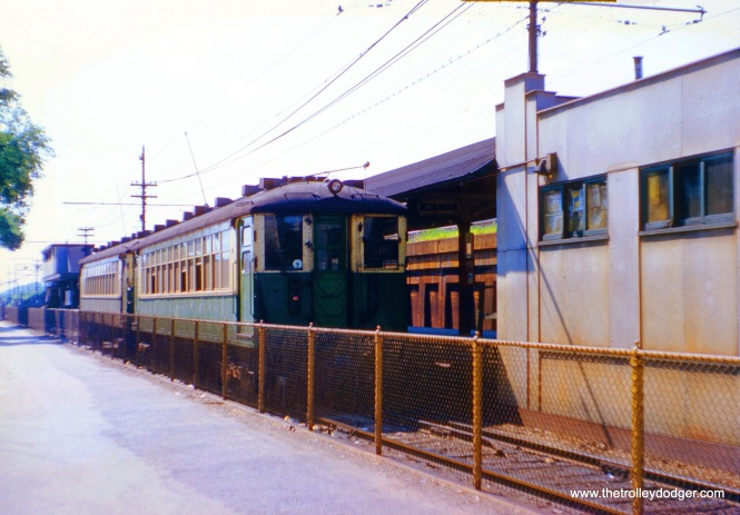 "A pair of CTA 4000s at Marion Street in Oak Park, along the old ground-level portion of the Lake Street ""L"", in May 1958. We are looking west. (J. W. Vigrass Photo)"