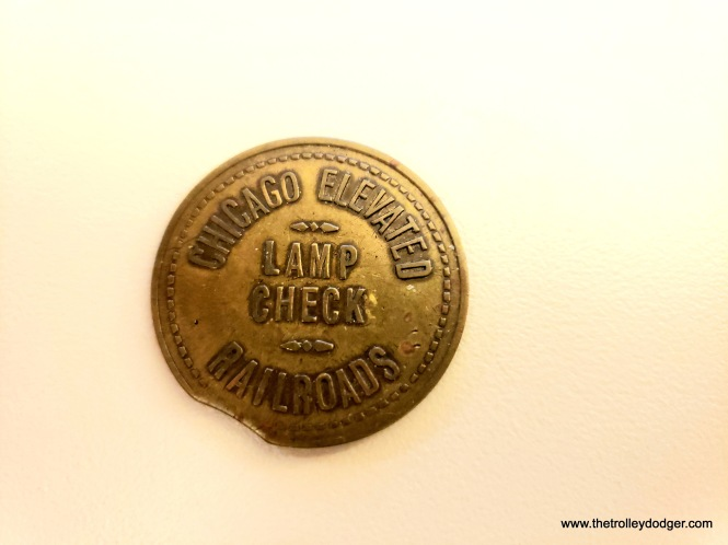 "I recently purchased this unusual single-sided token. I had to look up what a ""lamp check"" is. It seems that before heading out on a run, a motorman would exchange one of these tokens for a portable headlamp. At the end of the day, it would be exchanged for the token. (For a picture of just such a headlamp, see the North Shore Line photo at the beginning of this post.)"