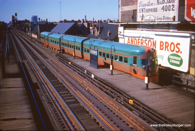 One of the two North Shore Line Electroliners heads south from the CTA's Belmont station on the North-South main line on July 3, 1961. The station has been rebuilt, and instead of an overhead transfer bridge, you cross at mezzanine level now.