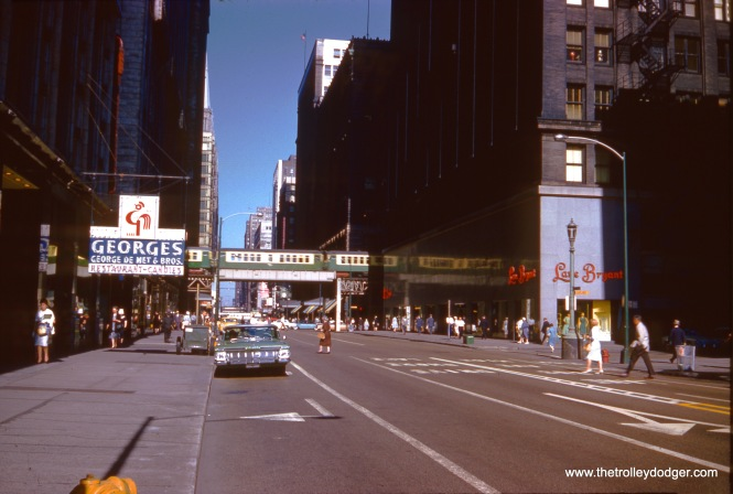 We are looking west along Washington Street at about 77 East on July 2, 1961. That is the Wabash leg of the Loop 'L'. Just out of view to the right would be the old main Chicago Public Library building, now the Cultural Center.