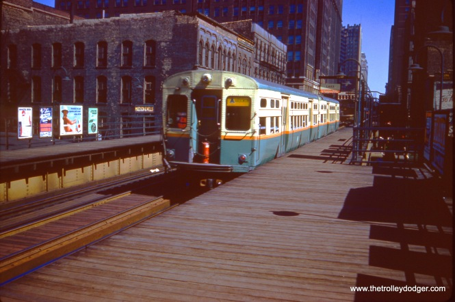 "A CTA two-car RAvenswood ""A"" train at Madison and Wells on July 3, 1961. Note the fire extinguisher at the front of the train."