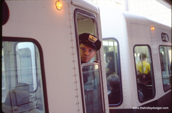 CTA trains are run by one person nowadays, but when this picture was taken (circa 1970) the doors were operated by conductors, and each train had a two-person crew.