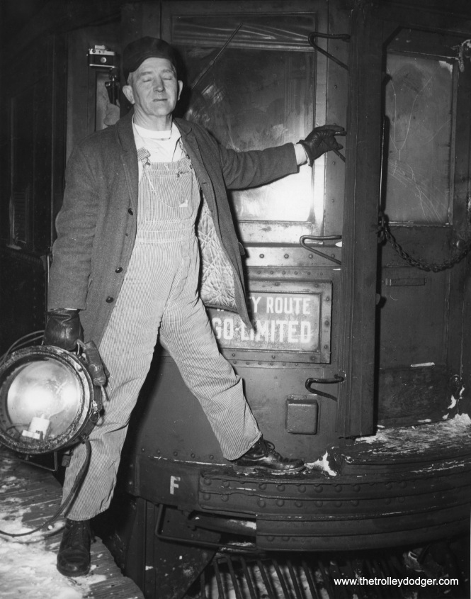In the early morning hours of a very cold January 21, 1963, motorman Bill Livings removes the headlight from the final North Shore Line interurban train, after it reached the end of the line at Roosevelt Road in Chicago. This was the end of the line for the fabled interurban in a very literal sense.