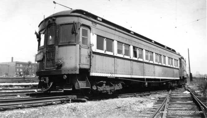 "CA&E 436. I am wondering if this might be at Laramie Yards in Chicago. Don's Rail Photos adds, ""305 was built by Niles Car & Mfg Co in 1906. It was wrecked and rebuilt in 1923 as 600, a buffet-parlor car. It was again rebuilt in 1929 as a coach to match the other 400s and numbered 436. It was scrapped in 1954."""
