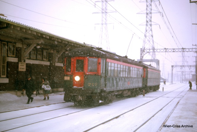 A northbound North Shore Line train stops at Dempster in January 1963, the final month. Just over a year later, after the abandonment, the CTA resumed service between here and Howard as the Skokie Swift. Note the sign at left for a yarn store in the terminal building. (Wien-Criss Archive)