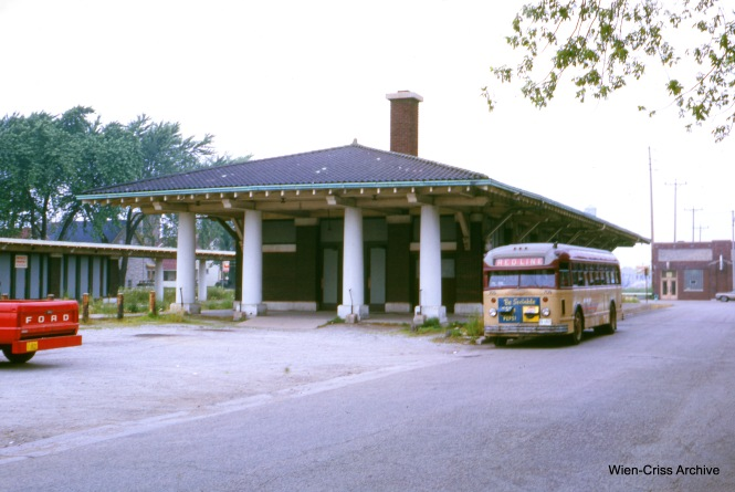 This and the following picture: A Kenosha Motor Coach bus is posed next to the former North Shore Line station circa 1967. The building remains, but has been altered over the years for use, first by a restaurant, then as a day care center. (Charles L. Tauscher Photo, Wien-Criss Archive)