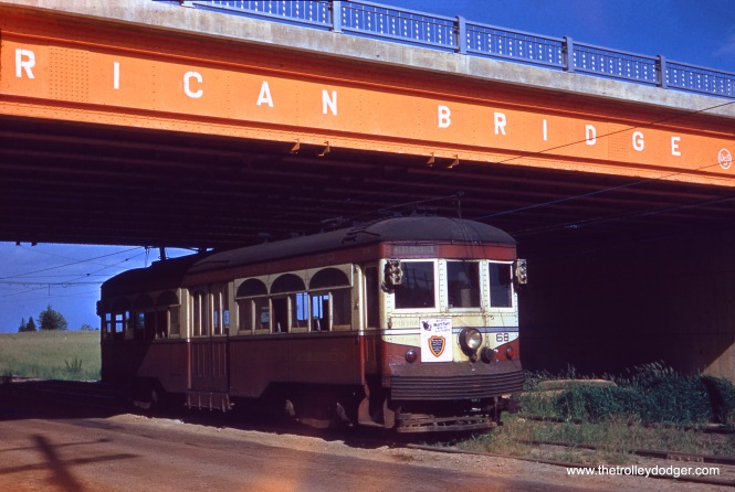There were several Red Arrow cars used in afantrip on the West Chester line in Philadelphia's suburbs on June 6, 1954, and car 68 appears to be one of them. There was a photo stop here at Patrick Avenue, and the bridge is highway 202. This 19-mile interurban line had good ridership, but fell victim to a project that widened West Chester Pike. It was replaced by buses.