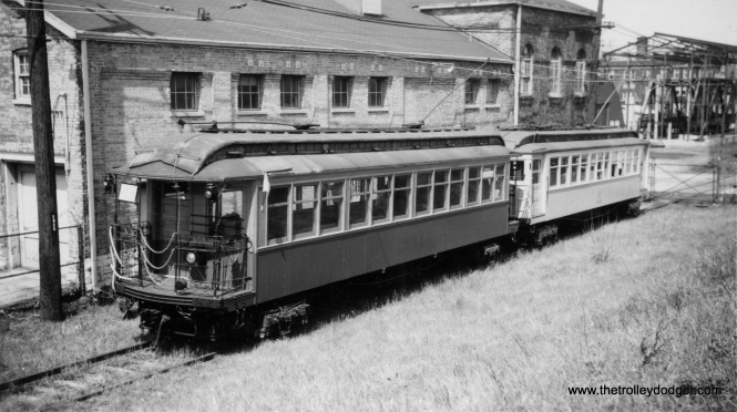 "In March 1958, the Illinois Electric Railway Museum ran a fantrip on parts of the CTA ""L"" system, using car 1024 and a work car. This was some months after the last wood car was used in regular service. Here, we see train on a siding in Evanston. We previously ran a photo of the same train on the Garfield Park ""L"" temporary trackage. 1024 went to IERM and has since been restored as car 24."