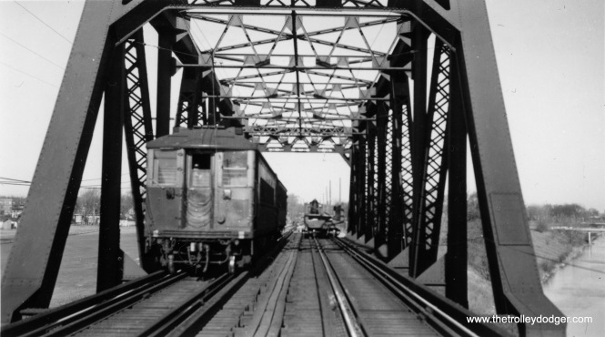 "4000s going over the North Shore Channel bridge in Evanston, when it appears to be brand new. Not sure of the date. Miles Beitler adds, ""It may have been taken during the elevation of the north end of the Evanston line from University Place to just north of Central Street. That project was completed in 1931. There would have been a bridge over the North Shore Channel long before then, as the channel was completed in 1910 and was crossed by a steam railroad at that point, but perhaps the elevation of the line required replacement or reconstruction of the existing bridge."""