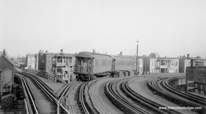 When the CTA realigned the north and south side routes, Kenwood became a shuttle. These wooden gate cars (200-series) are being stored on an otherwise unused track on the South Side main. The Kenwood branch itself is at left.