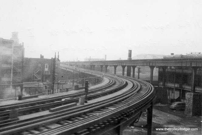 "This is the view looking south from the Lake Street ""L"" at Paulina on March 17, 1954. The tracks at right were where the Met ""L"" went over the Lake line. At left is a new connection, just about to be put into service, that allowed Douglas Park trains to go to the Loop via Lake Street. This connection was used from 1954 to 1958, and is now used again by Pink Line trains (the successor to Douglas)."