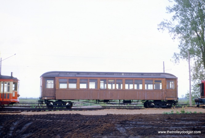 "A wooden Chicago ""L"" car at the Illinois Railway Museum in Union, May 1968. The museum had moved here in 1964 from its original location in North Chicago. I believe that is a Milwaukee streetcar at left."