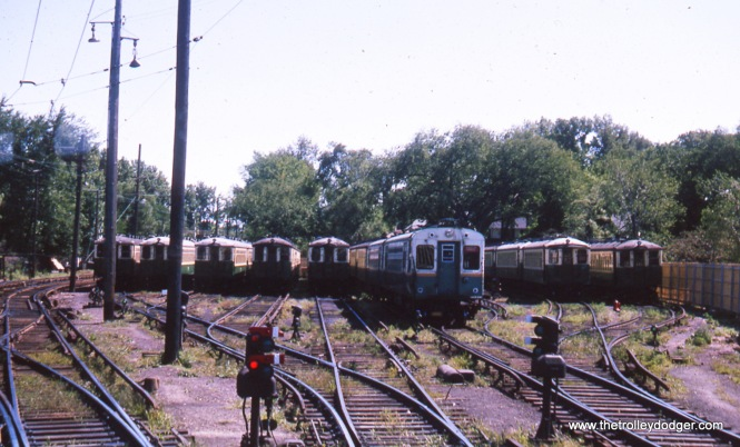 This August 1963 shot shows the yard at Linden Avenue in Wilmette, at the north end of the Evanston branch. There are overhead wires at left because this branch did not use third rail until 1973 (although the yard did). The station was behind the photographer, since moved to the left (east), I believe. To the left was also where the North Shore Line continued north on its own tracks for about a block, before heading west on Greenleaf Avenue.