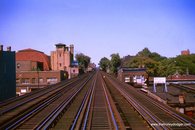 "DePaul University is near Fullerton Avenue on the North-South main line. There were four tracks north of Chicago Avenue on this line, with a few gaps between there and Howard Street, where the Evanston and Skokie branches begin. This August 1963 view, taken from out the window of a northbound train (as are some of the others) looks north to the Fullerton ""L"" station."
